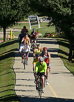 NWA Democrat-Gazette/BEN GOFF @NWABENGOFF<br /> Riders make their way through Rogers on Saturday Sept. 12, 2015 during the Square to Square Bicycle Fun Ride on the Razorback Regional Greenway. Cyclists of all ability levels rode roughly 30 miles of the trail from downtown Bentonville to downtown Fayetteville.