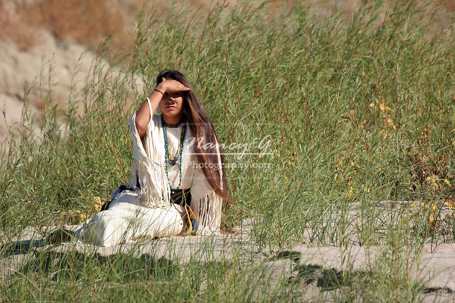 A Native American Indian women sitting along the riverbank in South Dakota