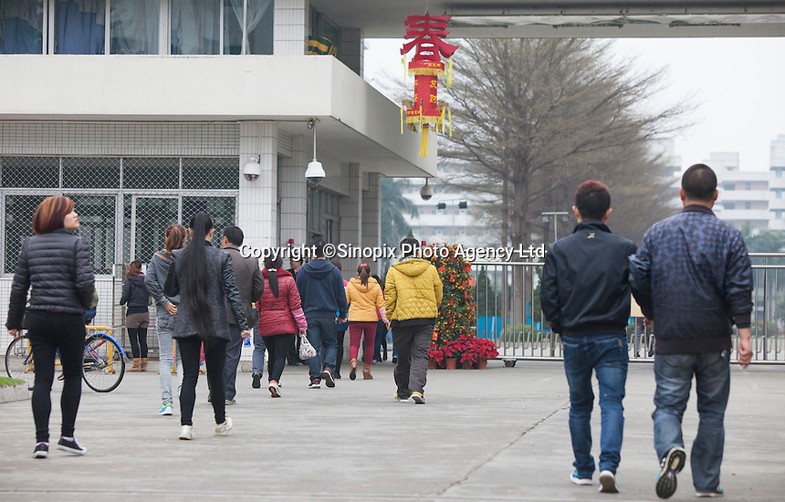 Workers arrive for work at the Yue Yuen Industrial Holdings Limited factory in Dongguan, Guangdong Province, China, 04 March 2015.