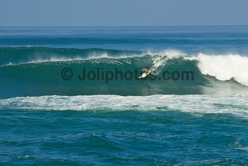 Haleiwa Hawaii, (Saturday December 25, 2010) .A new north swell hit the North Shore on Christmas day. It rose quickly through the morning and peaked in the afternoon around 10'. Sunset Beach and Rockpiles were the two best spots..Photo: joliphotos.com