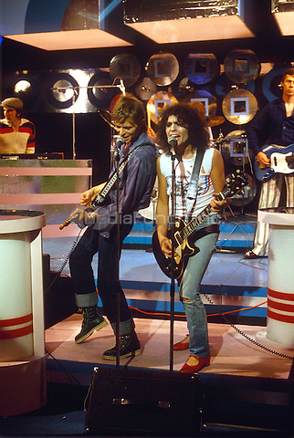 David Bowie &amp; Marc Bolan performing &quot;Standing Next to You&quot; on &quot;Marc&quot; - Bolan's Grenada TV show on September 9, 1977.<br /> *** NORTH AMERICA, SOUTH AMERICA &amp; JAPAN ONLY *** NO SALES TO: UK, EUROPE, RUSSIA or CHINA ***  HIGHER RATES APPLY *** CALL TO NEGOTIATE RATES***$150 MINIMUM ONLINE USAGE ***<br /> &copy; RTNSRock / MediaPunch
