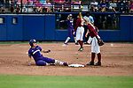 OKLAHOMA CITY, OK - JUNE 04: Taylor Van Zee #3 of the Washington Huskies slides into second base against the Florida State Seminoles during the Division I Women's Softball Championship held at USA Softball Hall of Fame Stadium - OGE Energy Field on June 4, 2018 in Oklahoma City, Oklahoma. (Photo by Tim Nwachukwu/NCAA Photos via Getty Images)