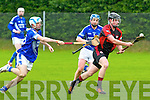 Alan O'Leary of Kenmare Shamrocks in action against Bryan Hannigan  and Peter Irwin   of Feenagh/Kilmeedy in the AIB Munster Club Junior Hurling Championship Quarter Final which took place on Sunday in Kevin Long Park, Feenagh.