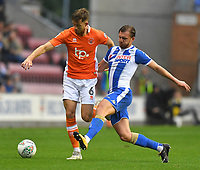 Blackpool's Will Aimson holds off Wigan Athletic's Alex Gilbey<br /> <br /> Photographer Dave Howarth/CameraSport<br /> <br /> The Carabao Cup - Wigan Athletic v Blackpool - Tuesday 8th August 2017 - DW Stadium - Wigan<br />  <br /> World Copyright &copy; 2017 CameraSport. All rights reserved. 43 Linden Ave. Countesthorpe. Leicester. England. LE8 5PG - Tel: +44 (0) 116 277 4147 - admin@camerasport.com - www.camerasport.com