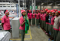 ETHIOPIA , Southern Nations, Hawassa or Awasa, Hawassa Industrial Park, chinese-built for the ethiopian government to attract foreign investors with low rent and tax free to establish a textile industry and create thousands of new jobs, taiwanese company Everest Textile Co. Ltd. , morning team instruction / AETHIOPIEN, Hawassa, Industriepark, gebaut durch chinesische Firmen fuer die ethiopische Regierung um die Hallen fuer Textilbetriebe von Investoren zu vermieten, taiwanesische Firma Everest Textile Co. Ltd., morgendliche Arbeitsbesprechung