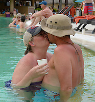 Allison & Jared's friends, Candace & Kevin Caldwell, kiss in the pool on Wednesday, two days before Allison & Jared's wedding in Punta Cana