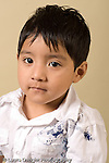 closeup headshot portrait of boy age 4 or 5 preschool age vertical