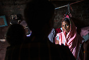 21 year old Seema Devi seen with her husband Vinay Paswan (22) and their 9 month old daughter, Vaishnavi Kumari in the small room of their hut in Shivpur Hariyya village in Raxaul district of Bihar.