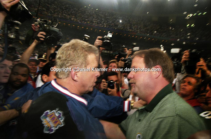 At the conclusion of Super Bowl XXXI at the Superdome in New Orleans New England Patriots head coach Bill Parcells and Green Bay Packers head coach Mike Holmgren meet at the center of the field for a brief congratulatory encounter on January 26, 1997.