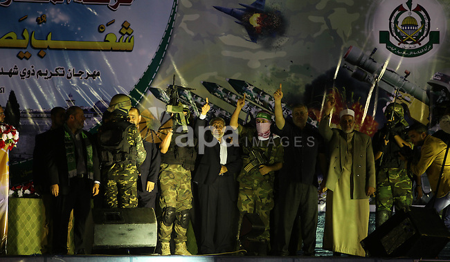 Senior Hamas leader Mahmoud al-Zahar attends a ceremony organised by his movement to honor the relatives of who killed by Israel during the summer's fierce offensive, in Khan Younis in the southern Gaza Strip, October 23, 2014. Photo by Ramadan El-Agha