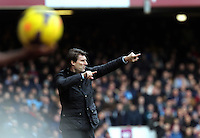 Pictured: Swansea manager Michael Laudrup shouts instructions to his players from the touchline. 01 February 2014<br /> Re: Barclay's Premier League, West Ham United v Swansea City FC at Boleyn Ground, London.