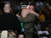 Stephen Bonanno (VIII) and Cody Ruggirello (IX) square off in the NY State Division One finals at the 119 weight class during the NY State Wrestling Championship finals at Blue Cross Arena on March 9, 2009 in Rochester, New York.  (Copyright Mike Janes Photography)