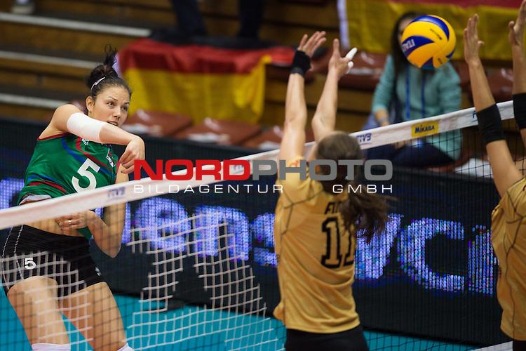05.10.2014, Pala Trieste, Triest<br /> Volleyball, FIVB Volleyball Women`s World Championship 2014, 2. Runde, Deutschland (GER) vs. Aserbaidschan (AZE)<br /> <br /> Angriff Odina Bayramova (Aliyeva) (#5 AZE) - Block / Doppelblock Christiane F&uuml;rst / Fuerst (#11 GER), Mareen Apitz (#20 GER)<br /> <br />   Foto &copy; nordphoto / Kurth