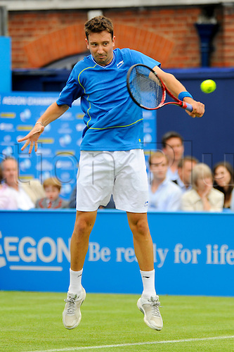 LONDON, UNITED KINGDOM, JUNE 7 2010: Alex Bogdanovic(GBR) makes a return in the rain affected first round match against Grigor Dimitrov (BUL) during the 2010 Aegon Championships at The Queens Club, London, United Kingdom.