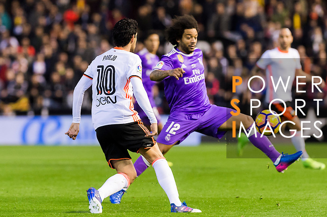 Marcelo Vieira Da Silva (r) of Real Madrid fights for the ball with Daniel Parejo Munoz of Valencia CF during their La Liga match between Valencia CF and Real Madrid at the Estadio de Mestalla on 22 February 2017 in Valencia, Spain. Photo by Maria Jose Segovia Carmona / Power Sport Images