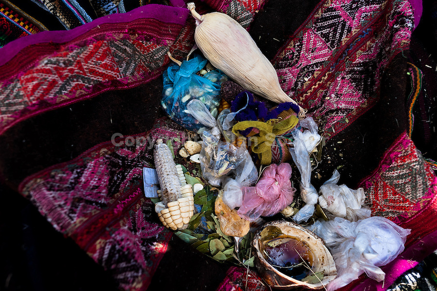 Magical objects belonging to an indigenous shaman viewed during the Yawar Fiesta, a ritual fight between the condor and the bull, held in the mountains of Apurímac, Cotabambas, Peru, 28 July 2012. The Yawar Fiesta (Feast of Blood), an indigenous tradition which dates back to the time of the conquest, consists basically of an extraordinary bullfight in which three protagonists take part - a wild condor, a wild bull and brave young men of the neighboring communities. The captured condor, a sacred bird venerated by the Indians, is tied in the back of the bull which is carefully selected for its strength and pugnacity. A condor symbolizes the native inhabitants of the Andes, while a bull symbolically represents the Spanish invaders. Young boys, chasing the fighting animals, wish to show their courage in front of the community. However, the Indians usually do not allow the animals to fight for a long time because death or harm of the condor is interpreted as a sign of misfortune to the community.