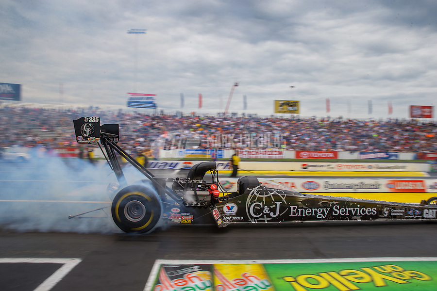 Jun 6, 2015; Englishtown, NJ, USA; NHRA top fuel driver Dave Connolly during qualifying for the Summernationals at Old Bridge Township Raceway Park. Mandatory Credit: Mark J. Rebilas-