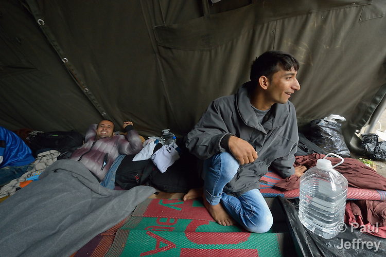 Men rest in a tent in a city park in Belgrade, Serbia. The park has filled with refugees on their way to western Europe from Syria, Afghanistan and other countries.