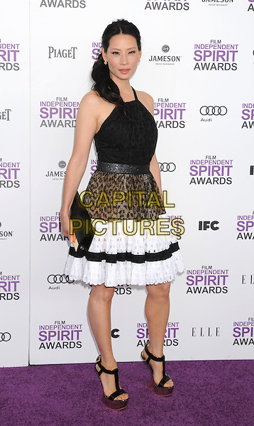 Lucy Liu.The 2012 Film Independent Spirit Awards at Santa Monica Pier in Santa Monica, California, USA..February 25, 2012.full length white black brown top leopard print skirt clutch bag.CAP/ROT/TM.©Tony Michaels/Roth Stock/Capital Pictures