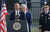 United States President Barack Obama makes his remarks at the 12th anniversary commemoration of the 9/11 terrorist attacks at the Pentagon Memorial at the Pentagon in Washington, DC on September 11, 2013. Nearly 3,000 people were killed in the attacks in New York, Washington and Shanksville, Pennsylvania. Behind him are U.S. Secretary of Defense Chuck Hagel and Chairman of of the Joint Chiefs of Staff General Martin Dempsey.   <br /> Credit: Pat Benic / Pool via CNP