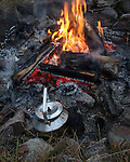 Campfire and coffeepot at hiking-trip in the Norwegian Forrest this fall
