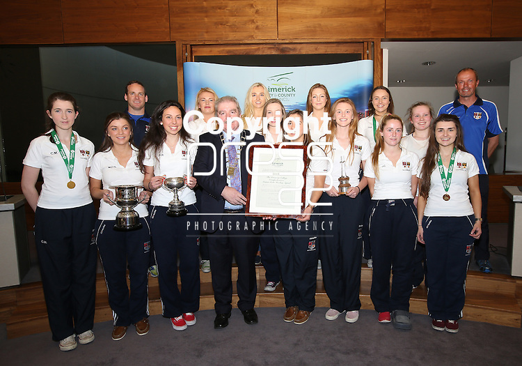 With compliments.  A Civic Reception on Wednesday evening last in the Council Chamber, Dooradoyle to honour the following  : The Irish Red Cross Limerick Area celebrating seventy five years of volunteer service to the people of Limerick City and County. The Under 20's Team 2014/2015 The Limerick Lakers Basketball Club in recognition of the Club winning The Cork County Cup, The Cork League Cup and The Cork League Top Four Playoff Cup and The Crescent College Comprehensive Senior Girls Hockey Squad in recognition of the Squad winning The All Ireland Kate Russell Hockey Tournament 2015.  Photographed at the event were the Mayor of Limerick Cllr Kevin Sheahan presenting the Parchment to the Crescent College senior hockey team and management.       Photograph Liam Burke/Press 22