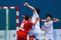 05 APR 2012 - LONDON, GBR - South Korea's Su-Young Jung (KOR) (centre) evades Tunisia's Issam Tej (left) to shoot during the men's 2012 London Cup match against Tunisia at the National Sports Centre in Crystal Palace, Great Britain (PHOTO (C) 2012 NIGEL FARROW)