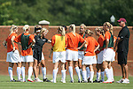 06 September 2009: Virginia Tech head coach Kelly Cagle (3rd from left) talks to her team. The Stanford University Cardinal defeated the Virginia Tech University Hokies 5-0 at UNCG Soccer Stadium in Greensboro, North Carolina in an NCAA Division I Women's college soccer game.
