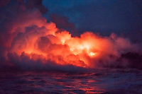 Lava flowing into ocean. Hawaii Volcanoes National Park,