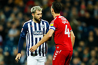 29th December 2019; The Hawthorns, West Bromwich, West Midlands, England; English Championship Football, West Bromwich Albion versus Middlesbrough; Charlie Austin of West Bromwich Albion squares up to Daniel Ayala of Middlesbrough - Strictly Editorial Use Only. No use with unauthorized audio, video, data, fixture lists, club/league logos or 'live' services. Online in-match use limited to 120 images, no video emulation. No use in betting, games or single club/league/player publications