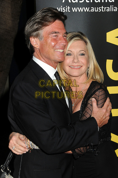 JOHN EASTERLING, OLIVIA NEWTON-JOHN.2011 G'Day USA Los Angeles Black Tie Gala held at the Hollywood Palladium, Hollywood, California, USA, .22nd January 2011..half length  black tie white shirt smiling couple wife husband dress sheer shrug jacket arms around hugging hug .CAP/ADM/BP.©Byron Purvis/AdMedia/Capital Pictures.