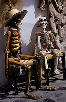 skeletons of man and wife on a chair in the dia de los muertes festival in Mexico. Day of the deads.