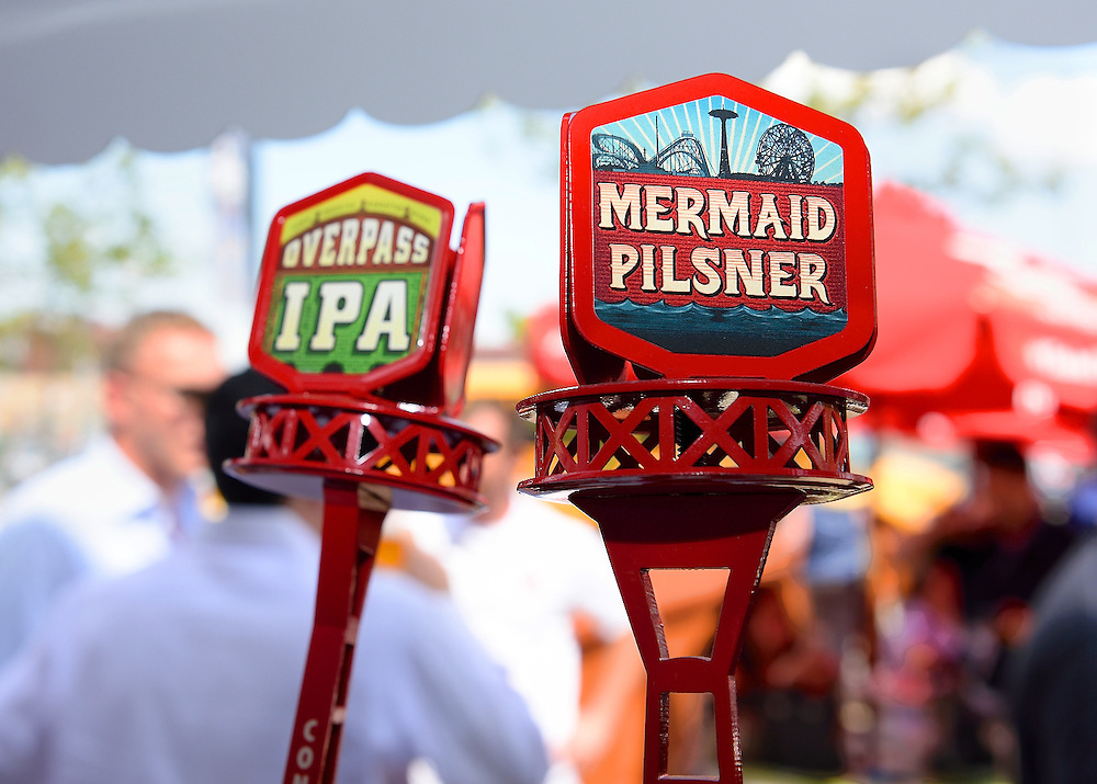 Overpass IPA and Mermaid Pilsner tap handles.