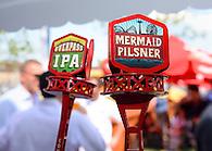 Overpass IPA and Mermaid Pilsner tap handles.