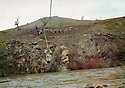 Iran 1991 <br /> On march 7th, Mullazem Omar crossing a river at the border of Iraq, the day of the liberation of Suleimania  <br /> Irak 1991 <br /> Le 7 mars, Mullazem Omar traverse une riviere a la frontiere de l'Irak, le jour de la liberation de Suleimania