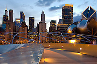 "Looking west from the BP bridge at Millenium Park with the Pritzker Pavillion, Michigan Avenue and Chicago's skyline at dusk. The architecture of Chicago has influenced and reflected the history of American architecture. The city of Chicago, Illinois features prominent buildings in a variety of styles by many important architects. Since most buildings within the downtown area were destroyed by the Great Chicago Fire in 1871, Chicago buildings are noted for their originality rather than their antiquity..Beginning in the early 1880s, architectural pioneers of the Chicago School explored steel-frame construction and, in the 1890s, the use of large areas of plate glass. These were among the first modern skyscrapers and amongst their most famous architects were William LeBaron, John Wellborn Root Sr., Daniel Burnham and Charles Atwood. Louis Sullivan was perhaps the city's most philosophical architect. Realizing that the skyscraper represented a new form of architecture, he discarded historical precedent and designed buildings that emphasized their vertical nature. This new form of architecture, by Jenney, Burnham, Sullivan, and others, became known as the ""Commercial Style,"" but it was called the ""Chicago School"" by later historians..Since 1963, a ""Second Chicago School"" emerged, largely due to the ideas of structural engineer Fazlur Khan. Some of Chicago's skyscrapers such as the John Hancock Center, Willis Tower (formerly known as the Sears Tower) and The Trump International Hotel and Tower are amongst the tallest buildings in the world."