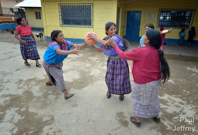 Maria Valentina Lopez holds the ball as indigenous women play basketball in Tuixcajchis, a small Mam-speaking Maya village in Comitancillo, Guatemala.