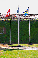 A Danish, French and Swedish flag in front of the chateau. Chateau de Haux Premieres Cotes de Bordeaux Entre-deux-Mers Bordeaux Gironde Aquitaine France