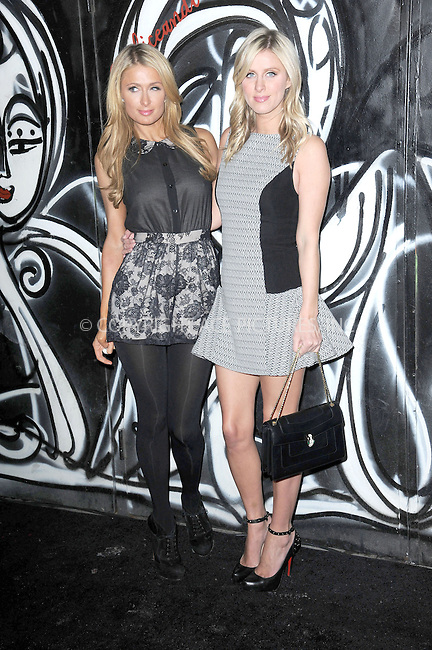 WWW.ACEPIXS.COM . . . . . <br /> February 10, 2014...New York City<br /> <br /> Paris Hilton and Nicky Hilton attending the Alice + Olivia Presentation at the the McKittrick Hotel on February 10, 2014 in New York City.<br /> <br /> Please byline: Kristin Callahan...ACEPIXS.COM<br /> Tel: (212) 243 8787 or (646) 769 0430<br /> e-mail: info@acepixs.com<br /> web: http://www.acepixs.com