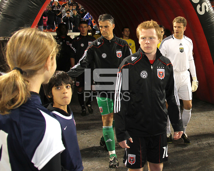 Dax McCarty#10 and Pat Onstad#20 of D.C. United during the opening match of the 2011 season against the Columbus Crew at RFK Stadium, in Washington D.C. on March 19 2011.D.C. United won 3-1.