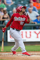 Memphis Redbirds outfielder Oscar Taveras #15 follows through on his swing during the Pacific Coast League baseball game against the Round Rock Express on April 24, 2014 at the Dell Diamond in Round Rock, Texas. The Express defeated the Redbirds 6-2. (Andrew Woolley/Four Seam Images)