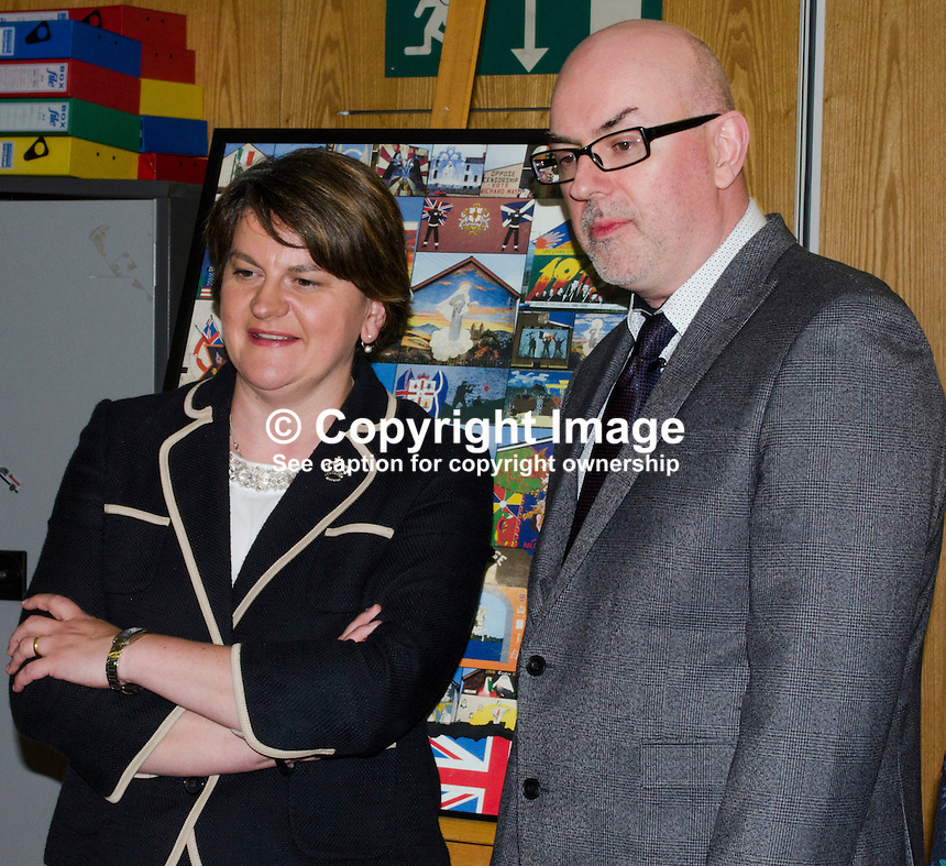 N Ireland First Minister Arlene Foster with Gavin Carville, manager, Divided Society Digitisation Project, during here 1st September 2016 visit to the Linen Hall Library, Belfast. 201609014170<br />
