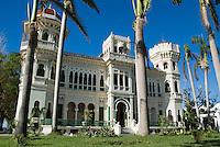 Palm trees in front of the Palacio de Valle on Punta Gorda, Cienfuegos, Cuba.