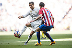Cristiano Ronaldo (l) of Real Madrid fights for the ball with Diego Roberto Godin Leal of Atletico de Madrid during their La Liga match between Real Madrid and Atletico de Madrid at the Santiago Bernabeu Stadium on 08 April 2017 in Madrid, Spain. Photo by Diego Gonzalez Souto / Power Sport Images