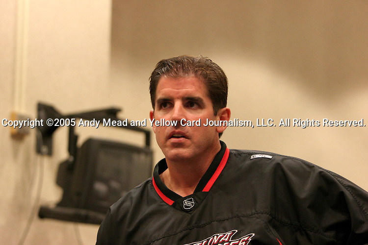 Peter Laviolette, head coach of the Carolina Hurricanes, nervously watches TV coverage of the NHL draft lottery on Friday, July 22, 2005, at the RBC Center in Raleigh, North Carolina. The Hurricanes ended up with the third pick in the draft.