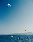 CROATIA, Bol, Brac, Dalmatian Coast, kite surfers along Zlatni Rat Beach.