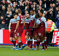1st February 2020; London Stadium, London, England; English Premier League Football, West Ham United versus Brighton and Hove Albion; West Ham United players celebrate with goal scorer Issa Diop 1-0 in minute 30