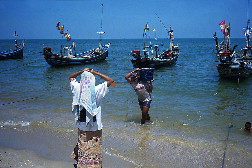 Fisherman wife waiting her husband with fish