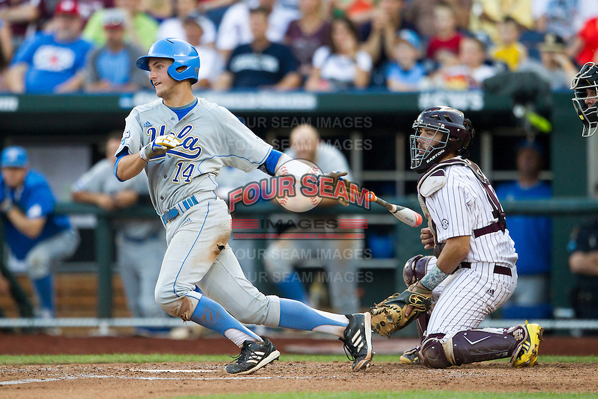 UCLA catcher Shane Zeile (14) follows through on his swing during Game 1 of the 2013 Men's College World Series Finals against the Mississippi State Bulldogs on June 24, 2013 at TD Ameritrade Park in Omaha, Nebraska. The Bruins defeated the Bulldogs 3-1, taking a 1-0 lead in the best of 3 series. (Andrew Woolley/Four Seam Images)