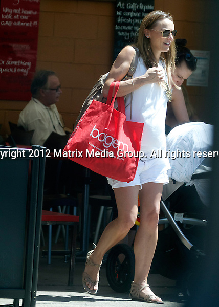9 January 2013 SYDNEY AUSTRALIA ..EXCLUSIVE ..Natalie Gruzlewski rubs her growing belly as she leave her local Mermaid Beach cafe with a friend....*No internet without clearance*.MUST CALL PRIOR TO USE ..+61 2 9211-1088.Matrix Media Group.Note: All editorial images subject to the following: For editorial use only. Additional clearance required for commercial, wireless, internet or promotional use.Images may not be altered or modified. Matrix Media Group makes no representations or warranties regarding names, trademarks or logos appearing in the images.